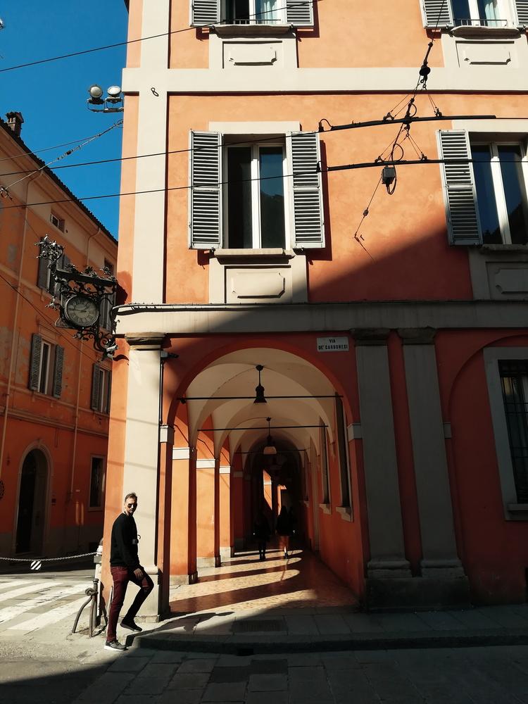Pretty archways casting shadows along a quiet street.