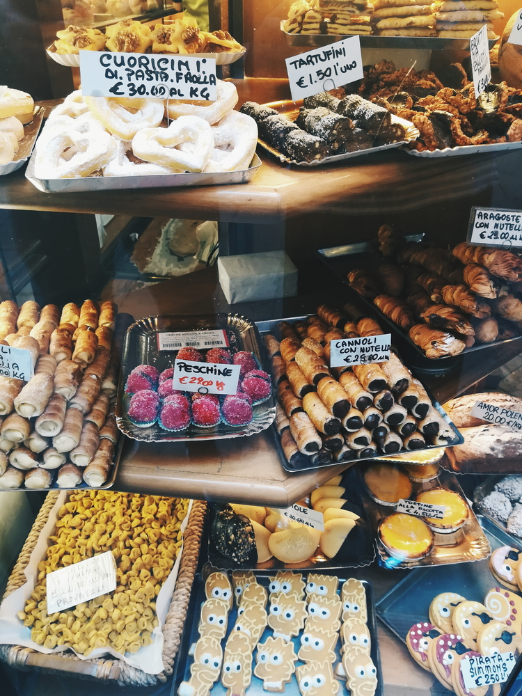 A wonderful selection of sweets. breads and cheeses at Paolo Atti & Figli.