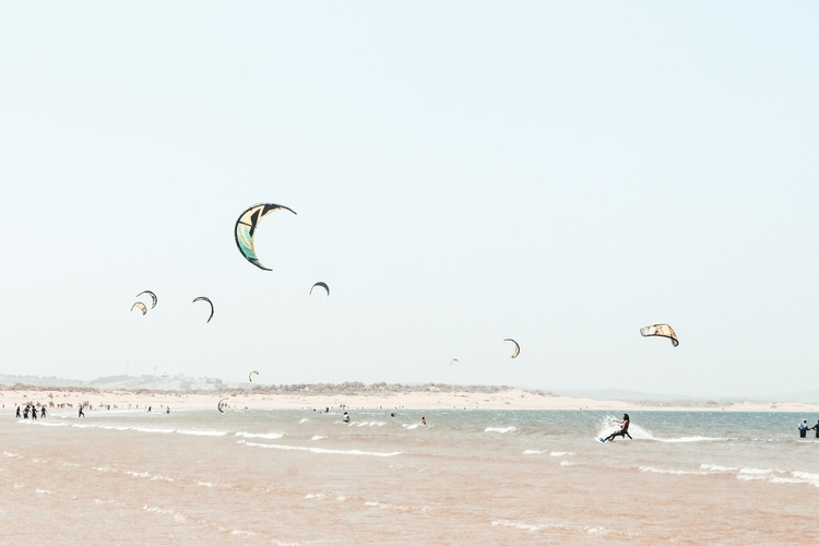 Wind surfing with glider in Essaouira, Morocco.