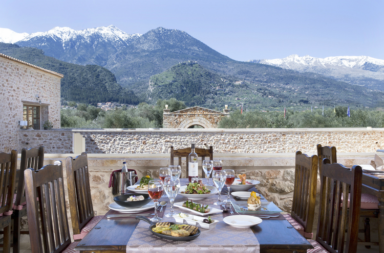 Glorious lunch view with the mountain range in full view at Mystras Palace Resort.