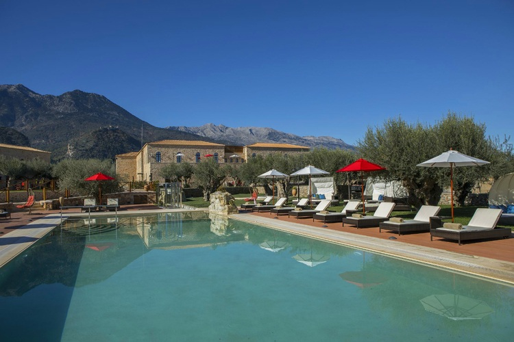 The natural landscapes surrounding the pool at Mystras Palace Resort.