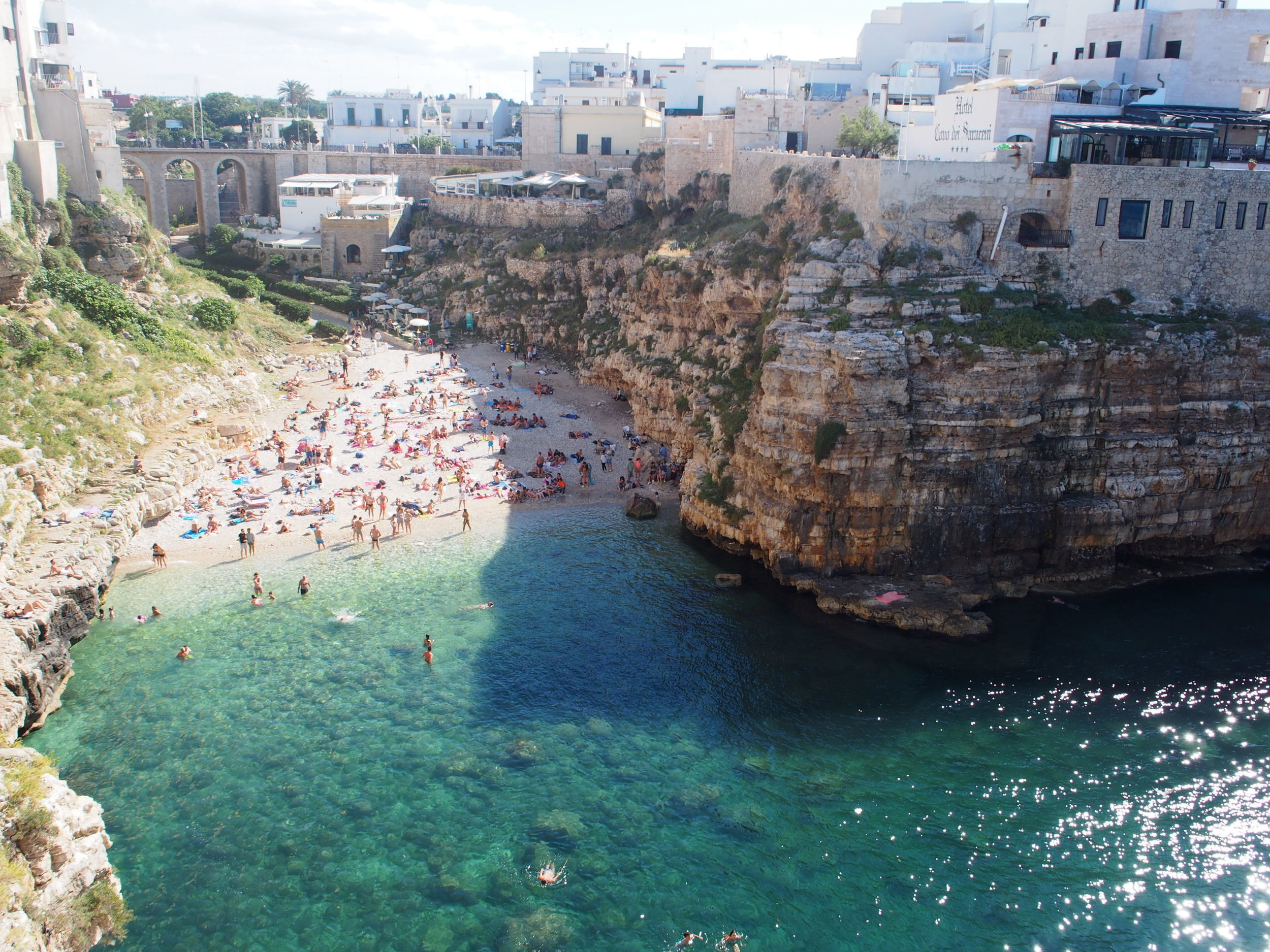 A true discovery, Polignano a Mare rises vertically above the Adriatic Sea. This amazing beach was the official setting for the Red Bull Cliff Diving World Series in 2015.