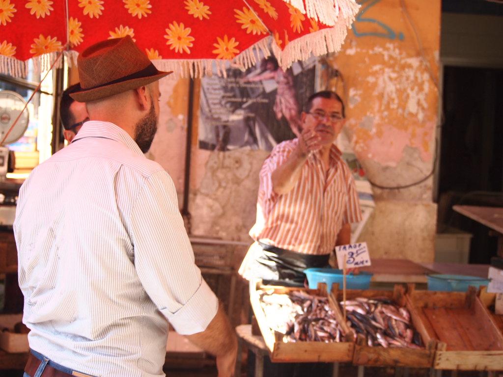 Picking fresh fish at Palermo's Ballarò market with tour guide Don Saro.
