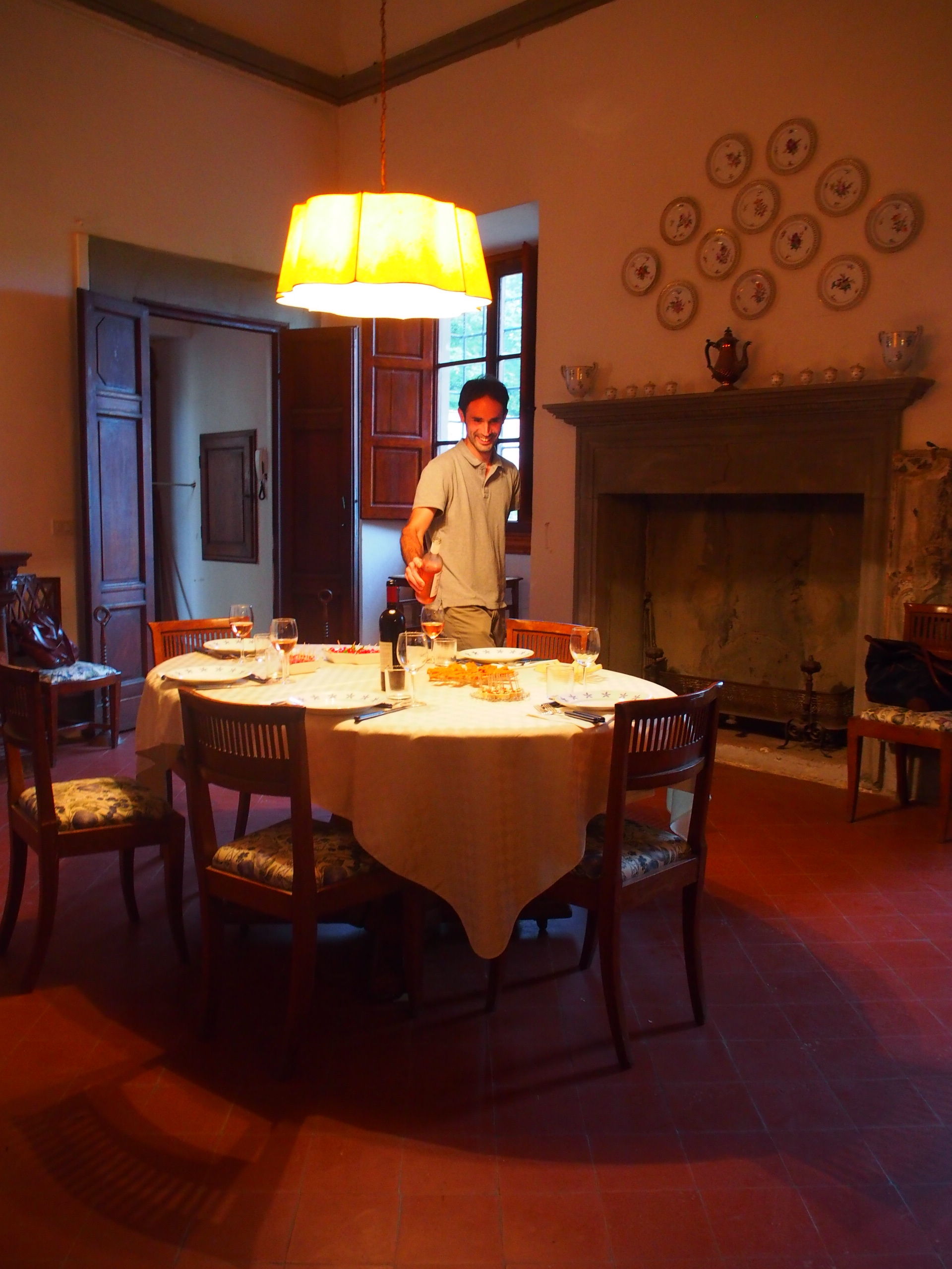 Here is pictured our personal 1/2 of our tour guides, Alessio, happily setting the table at Antinori family's Renaissance Villa Il Cigliano. We devoured their produced-wine, cheese, salad and a pasta dish.