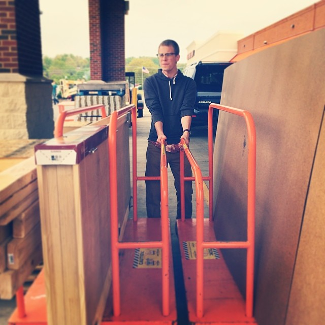 Craig hauls the Home Depot load of materials to build the embalming room set.