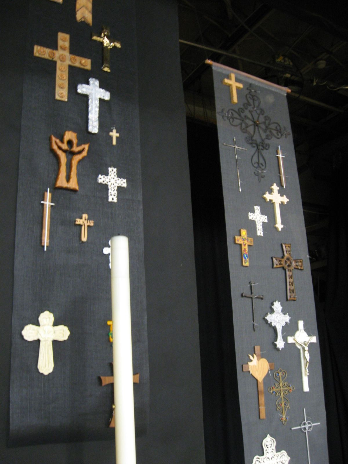 Close-up, devotional crosses on window screening