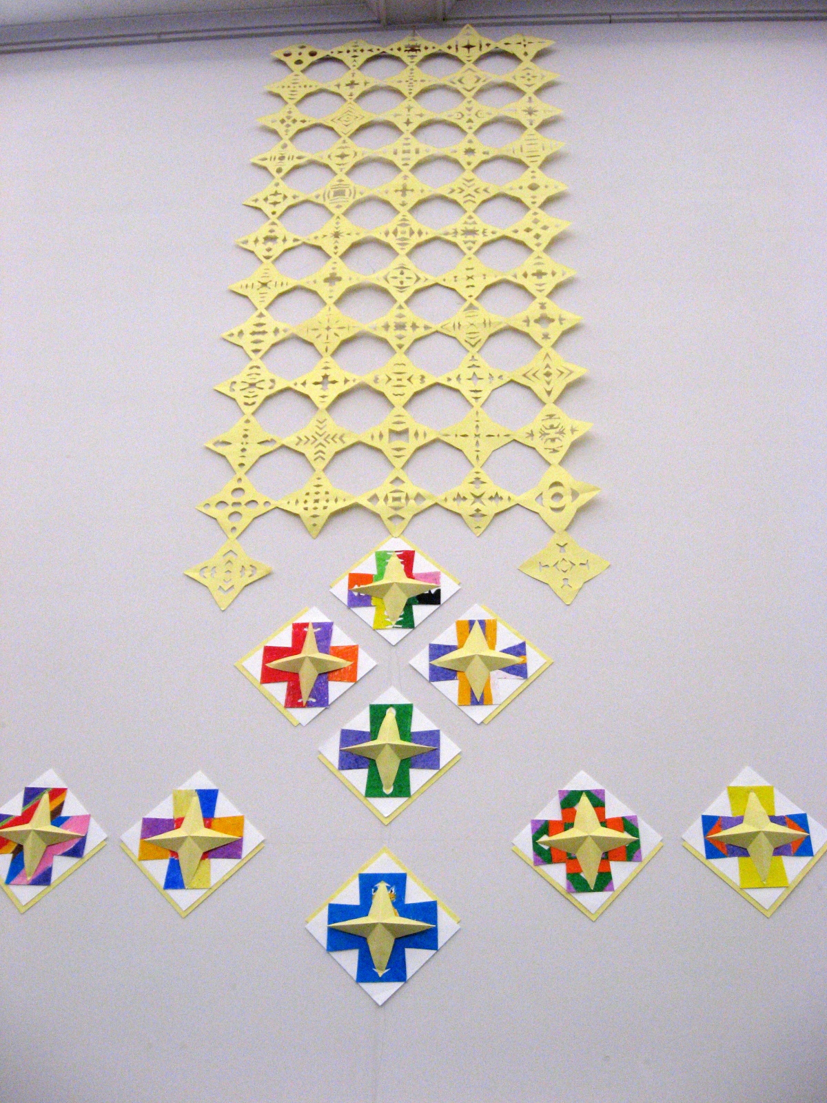 Center Nave wall (1 of 2), cut paper stars and community-made Greek crosses