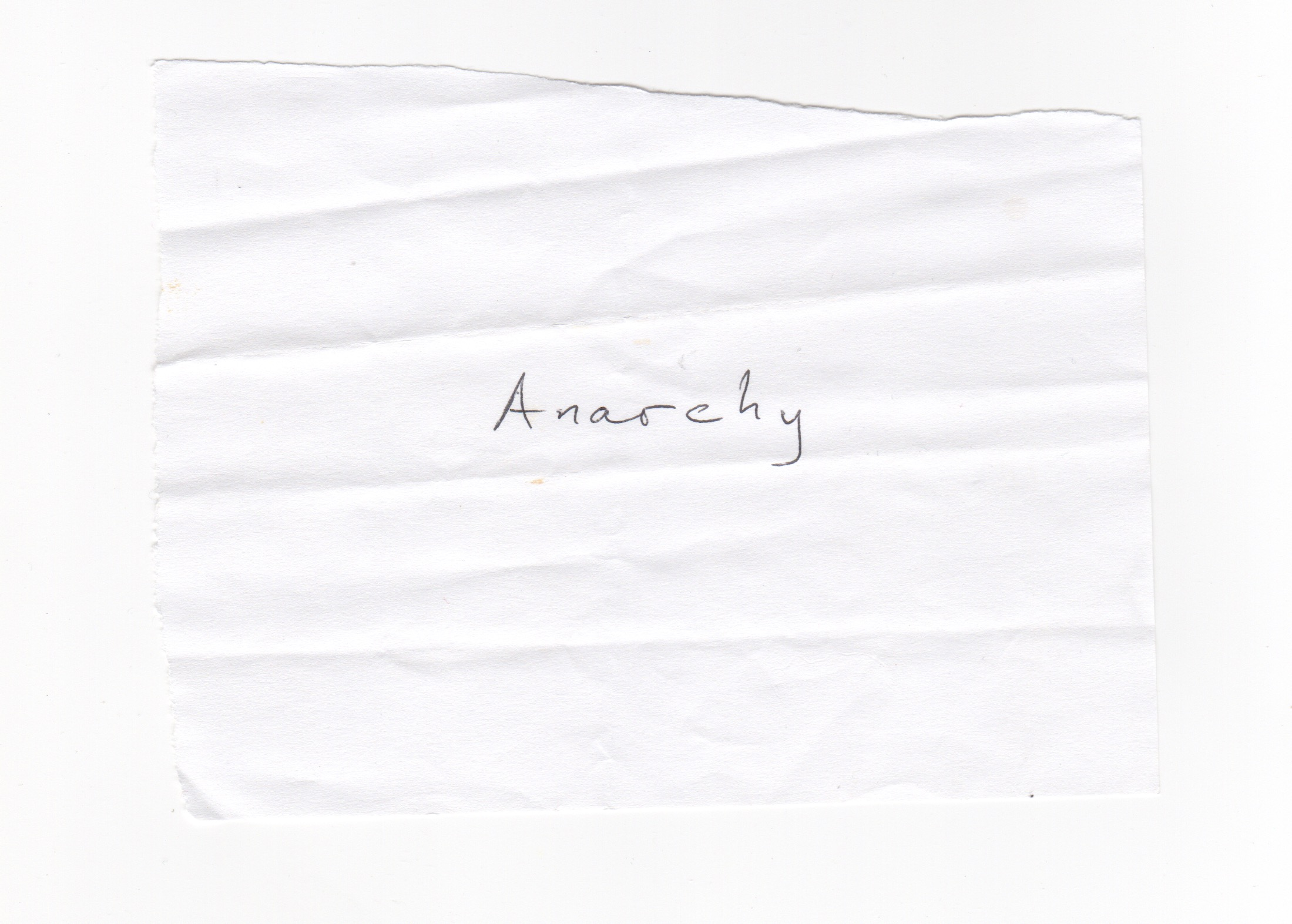 Found on the street. Anarchy simply written, in the centre of the ripped piece of paper.