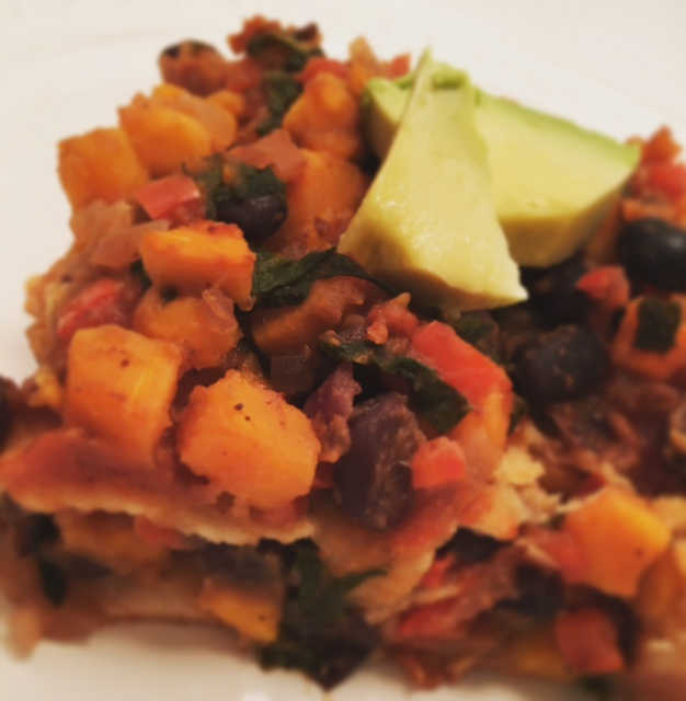 The Oh She Glows Cookbook enchiladas with extra filling and avocado on-top.