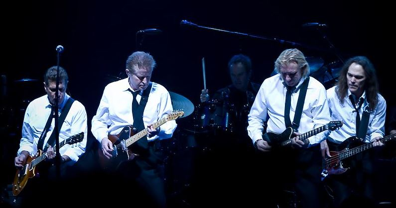 The Eagles in concert, making magic with their guitars, voices, and memorable songs.