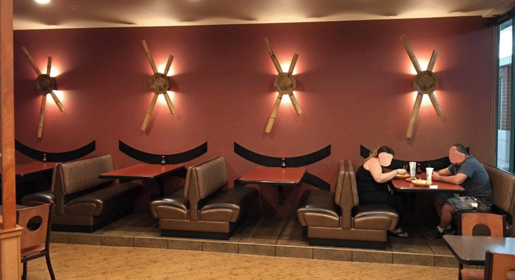 Noodle Mural With Disguised Patrons.png
