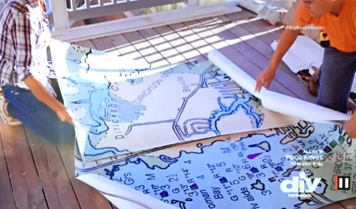 "In the ""Captain's Paradise"" on the DIY Network, Marnie Oursler opens the box of nautical chart mural panels, and plans out the installation onto the living room wall."