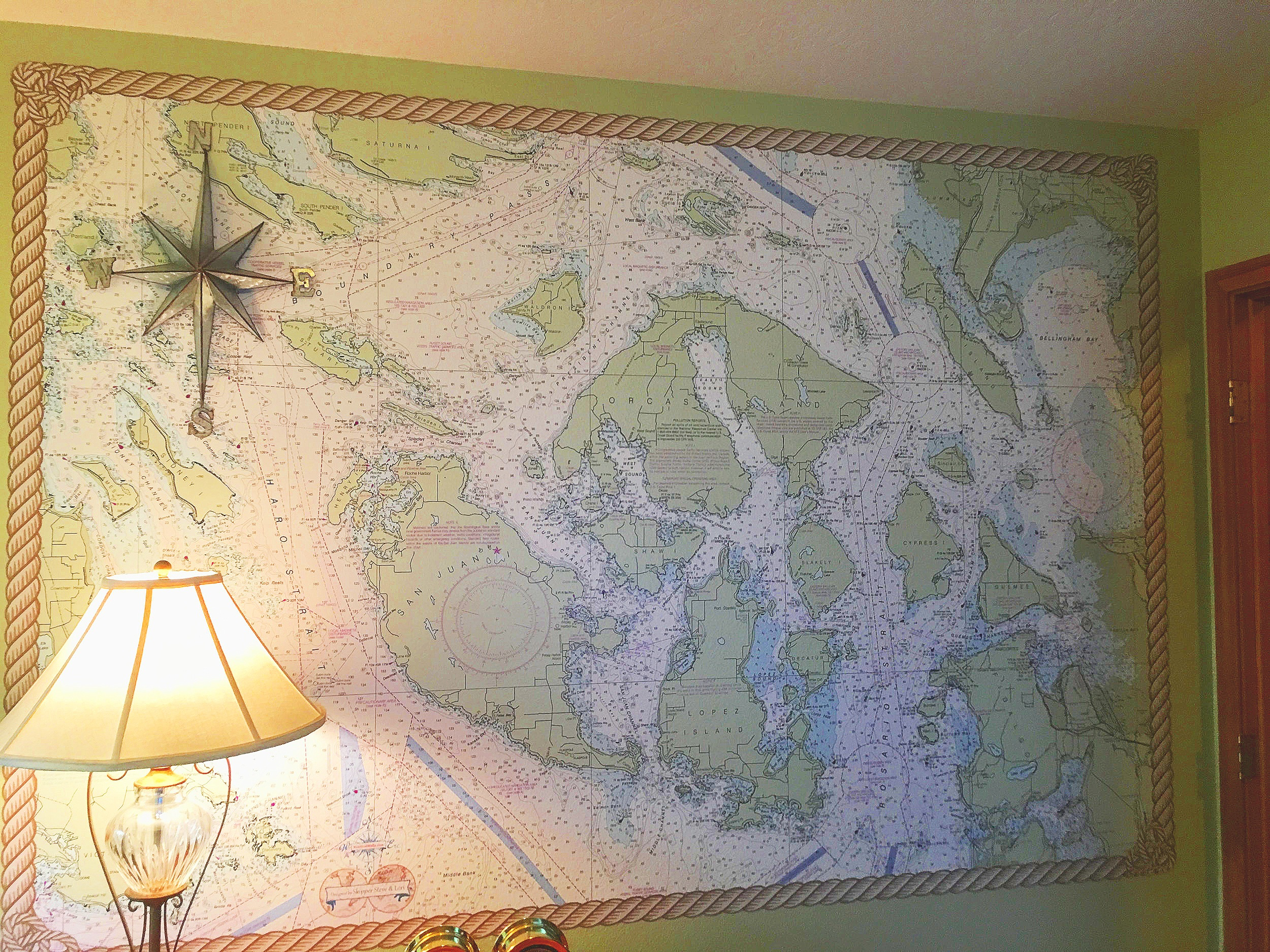 This is the mural in our office! We created the rope border as part of the mural. The San Juan Islands are Skipper's favorite sailing waters, and make a splended wall. The steampunk compas rose was found at Hobby Lobby..