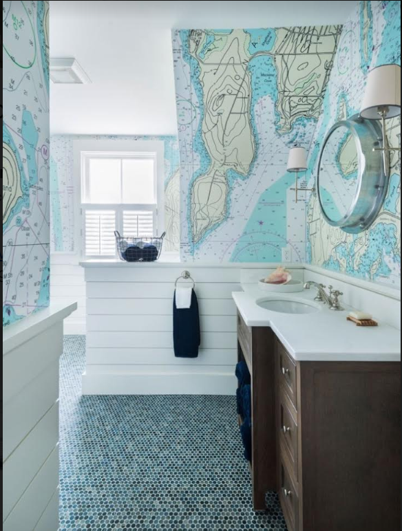 This bathroom is a wonderful mix of tiles and Nautical Chart Wallpaper.
