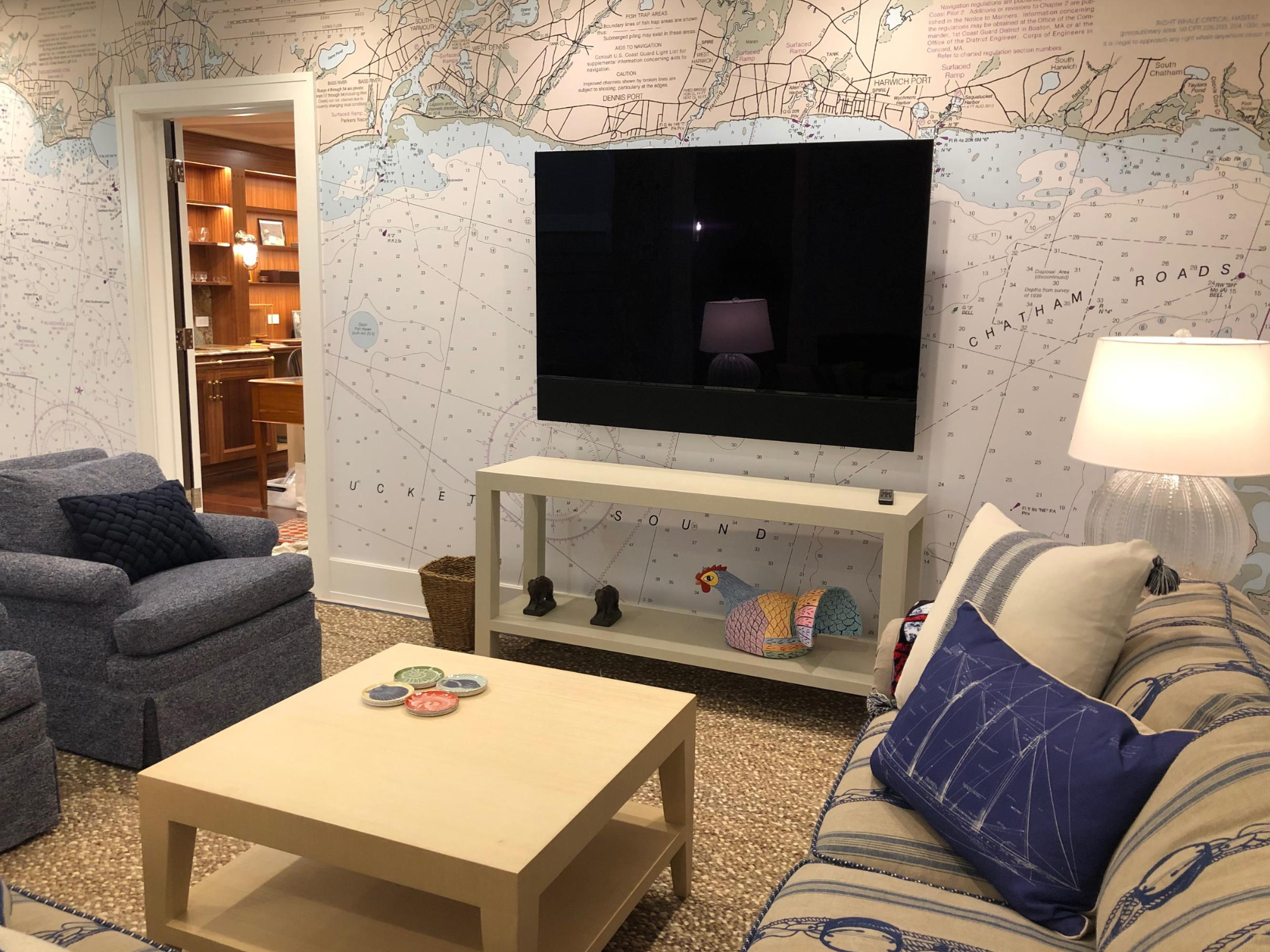 A Nautical Chart Wallpaper Mural sets the mood for this nautical family room.