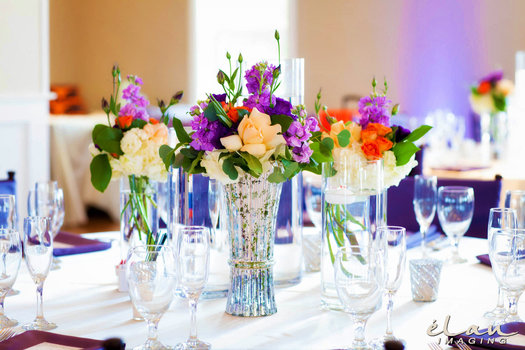 Vintage floral centerpieces from De Vinnie's Paradise, linens from Events by Reese, China settings from Heavenly Gourmet.