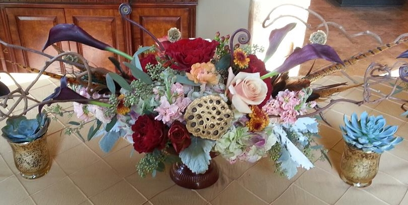 Floral centerpiece by  Eden's Echo