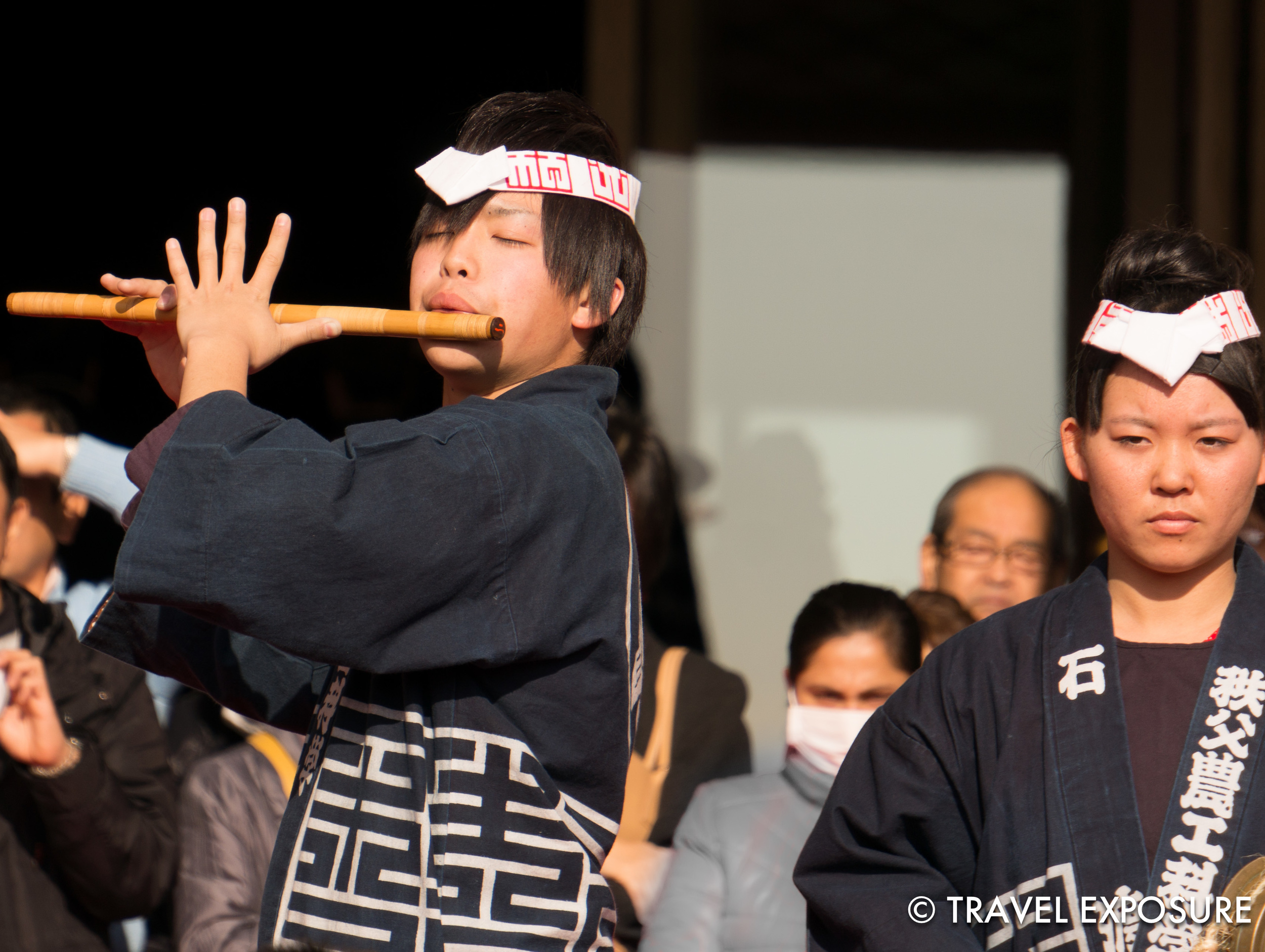 WEEK OF JANUARY 6 A flute player performs with a Taiko Japanese drum ensemble as part of the New Year's celebrations at the Tokyo National Museum.