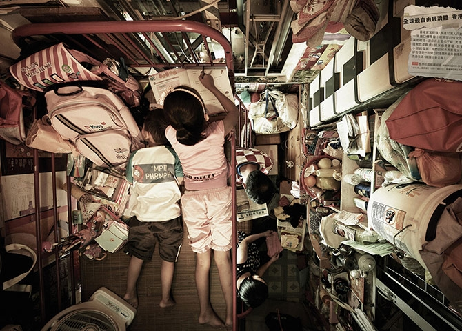 A family in their Hong Kong flat. Photograph by Society for Community Organization.