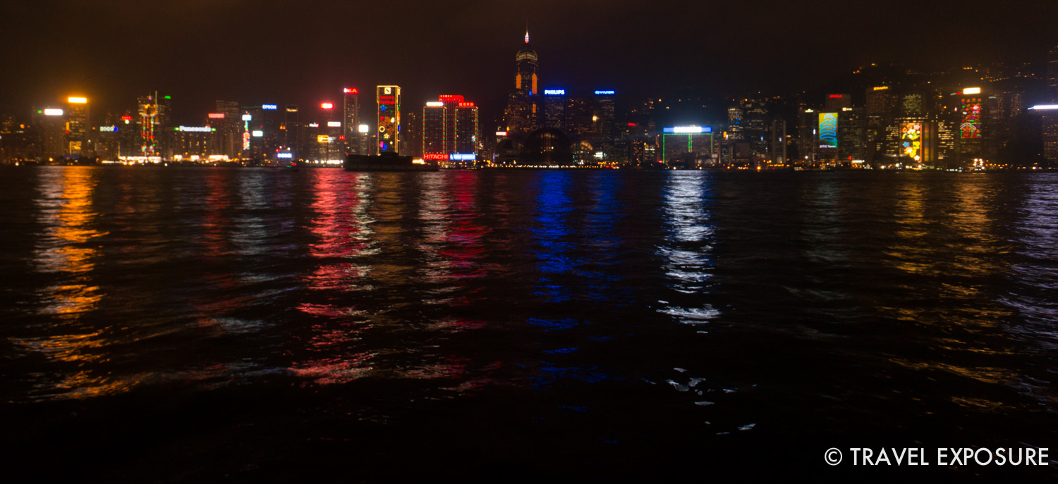 The Hong Kong skyline glimmers in the waters of Victoria Harbour