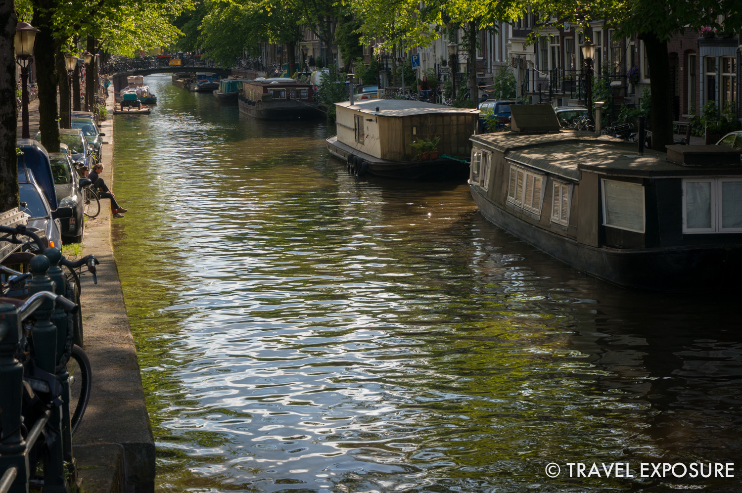WEEK OF MAY 19   A couple enjoys the sunshine along the edge of the Bloemgracht canal in Amsterdam, Netherlands.