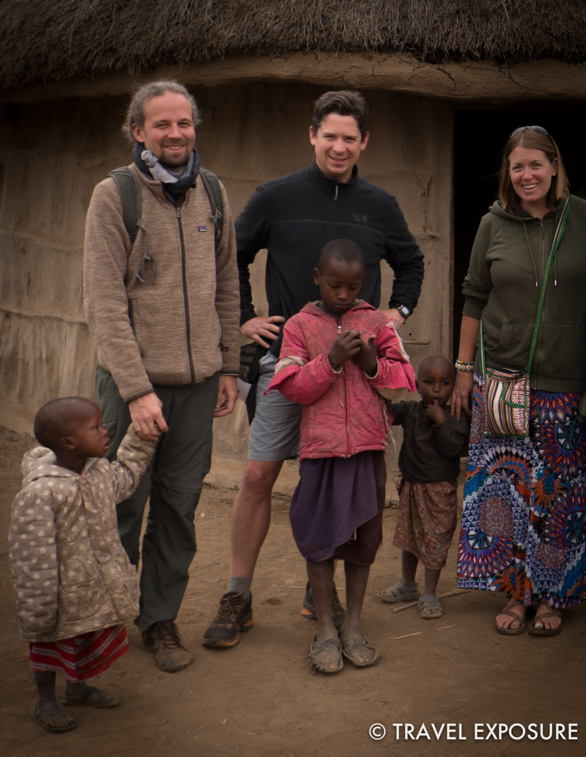 Root, Tommy and I visiting a Masai village in Tanzania.