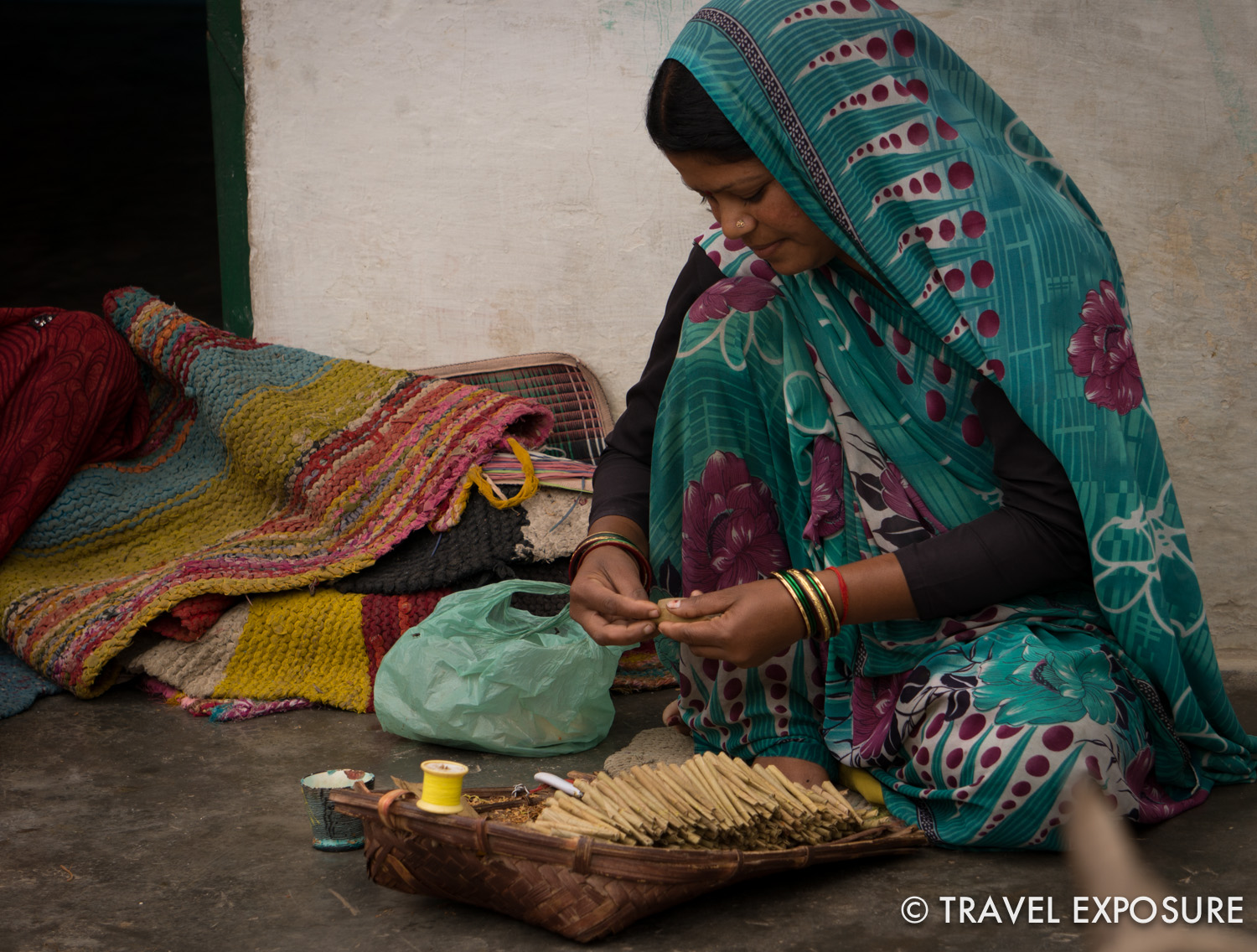 A woman in  Alipura village  rolls beedi, a type of indian cigarette