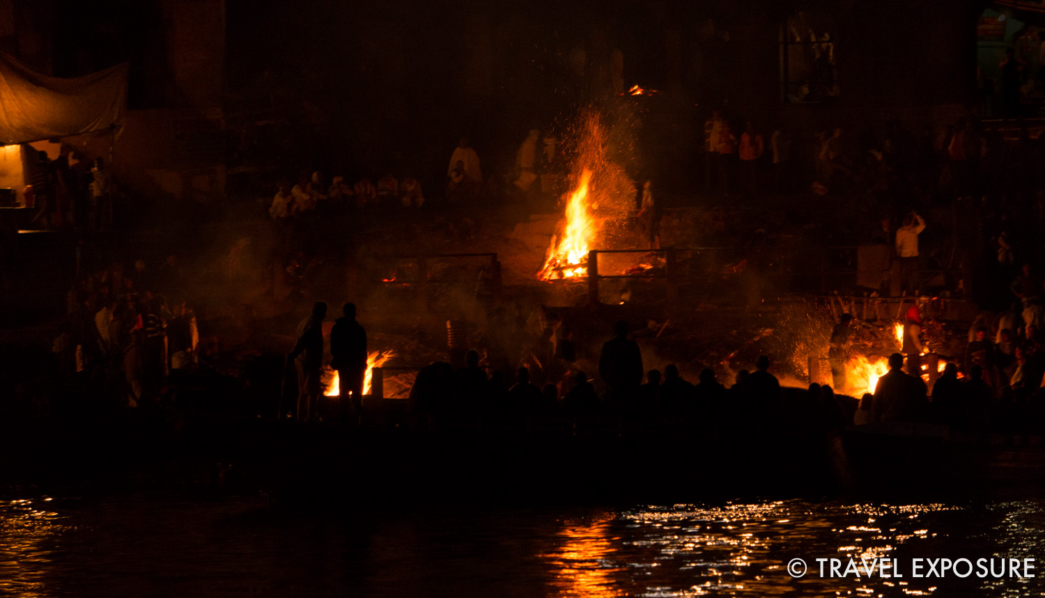 A cremation on the banks of the Ganges river in Varanasi. Having your ashes spread in the river, or even dying in Varanasi, is thought to help break the cycle of reincarnation giving salvation to the deceased.