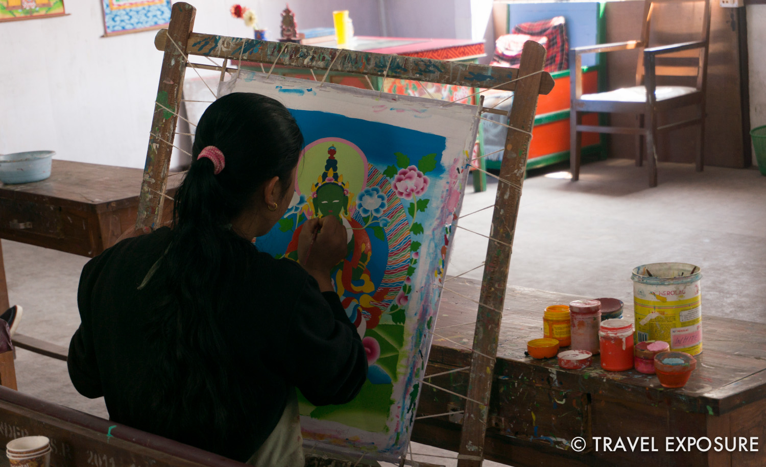 Students practicing thangka painting in Gangtok, Sikkim. A Thangka is a painting typically portraying a Buddhist deity, scene, or mandala.