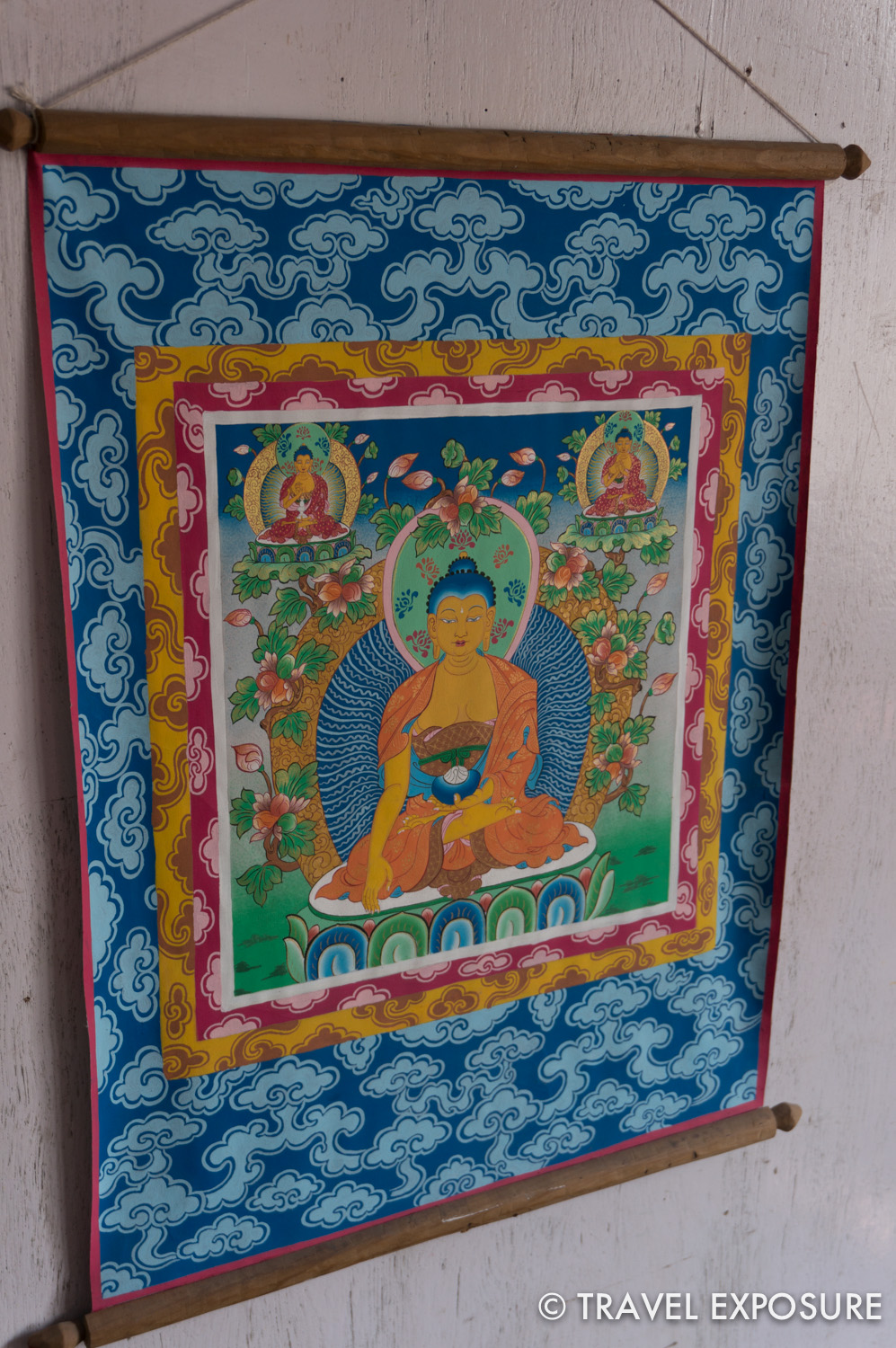 A thangka painting in Gangtok, Sikkim. A Thangka is a painting typically portraying a   Buddhist deity, scene, or mandala.