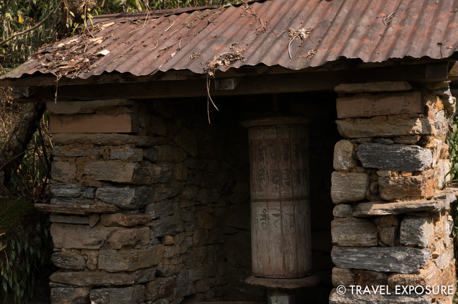 Old prayer wheel on the path up to Dubdi Monastery i n Yuksom, Sikkim