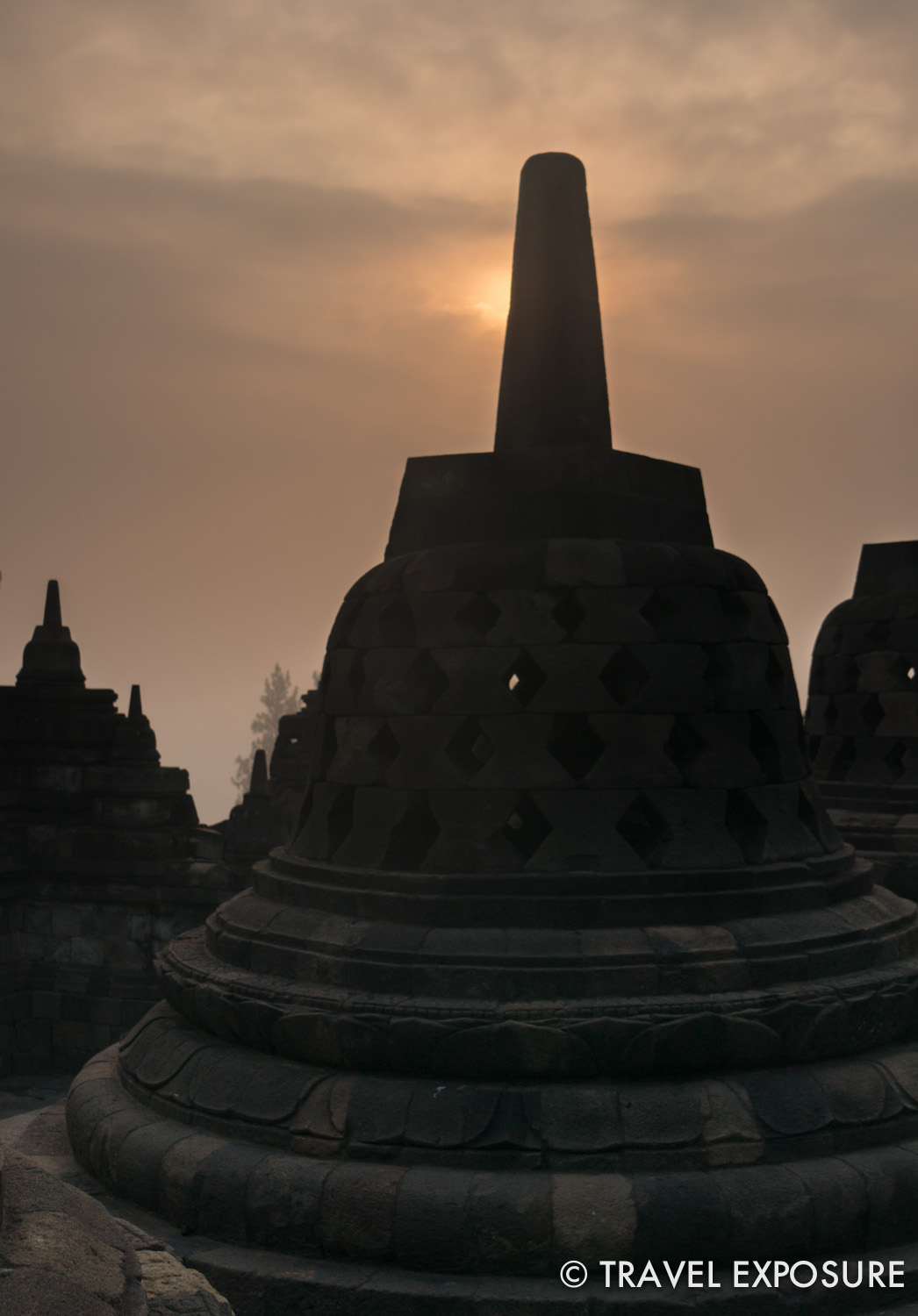 WEEK OF AUGUST 11 Sunlight peeks through a stupa at Borobudur Temple in Indonesia, one of the largest Buddhist monuments in the world.