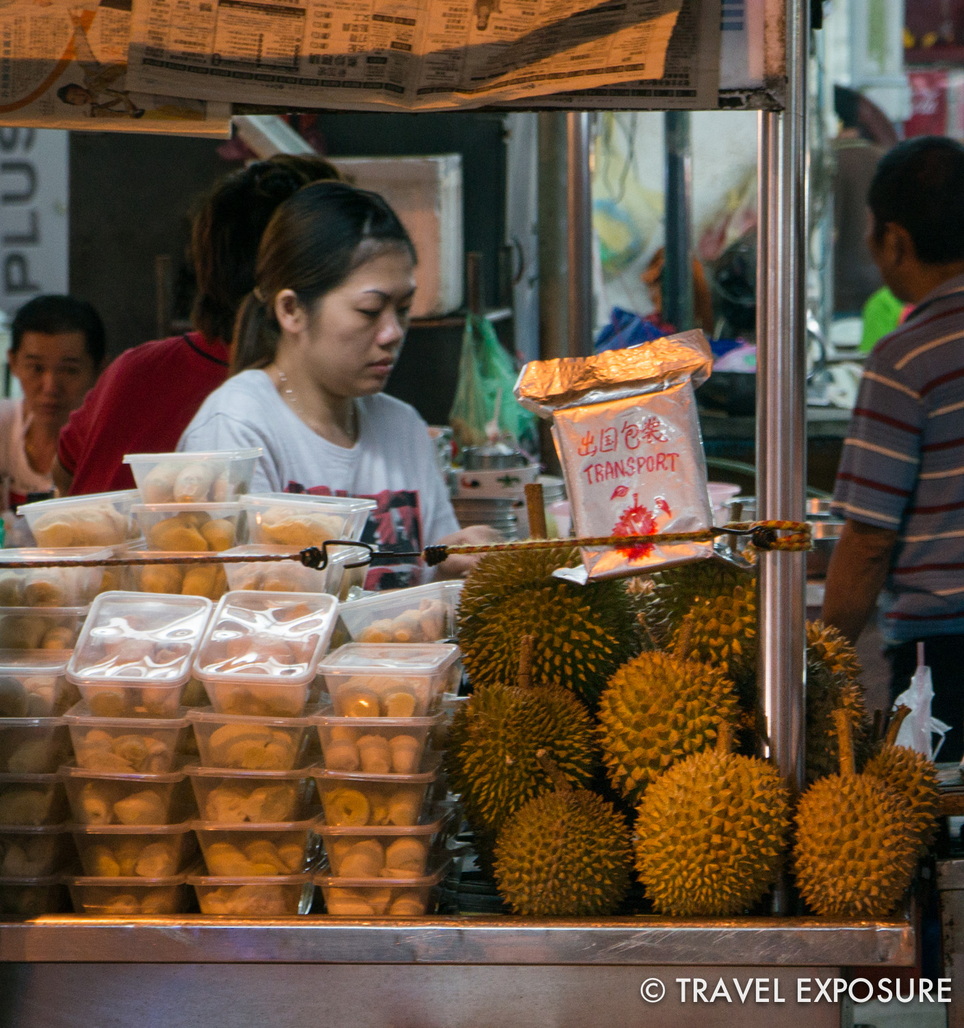 "Durians...an unusual delicacy in Asia. Note the special ""TRANSPORT"" bag."