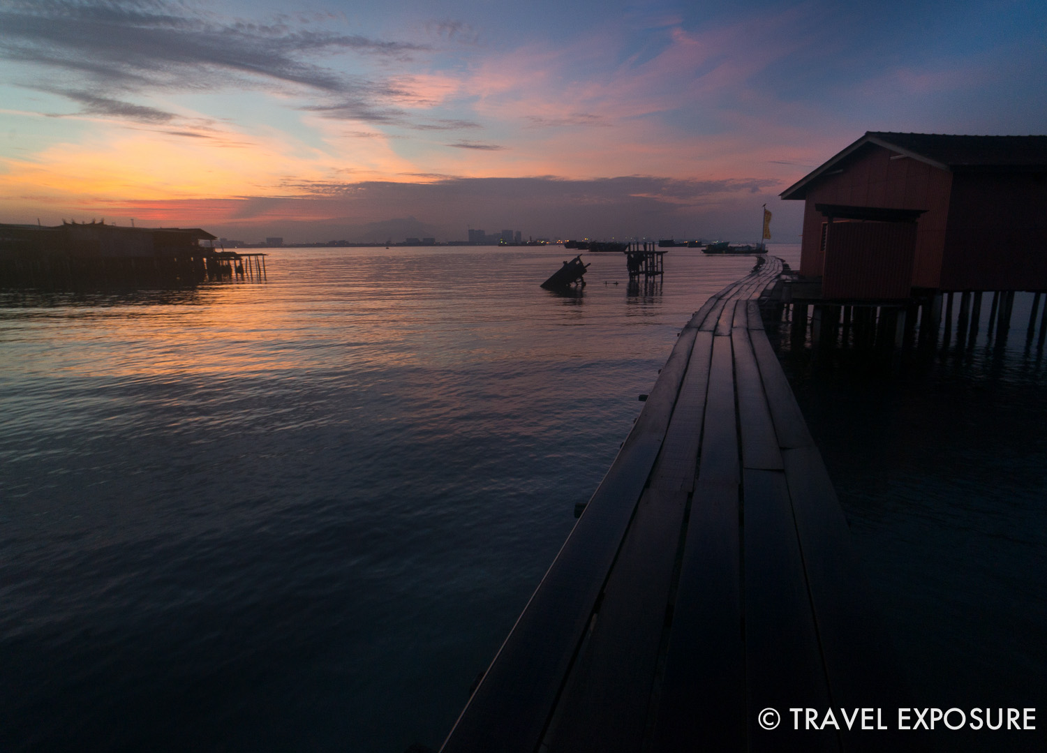 WEEK OF SEPTEMBER 22   The sun rises over Tan Jetty, one of the centuries-old Chinese clan jetties on the waterfront in Penang, Malaysia.