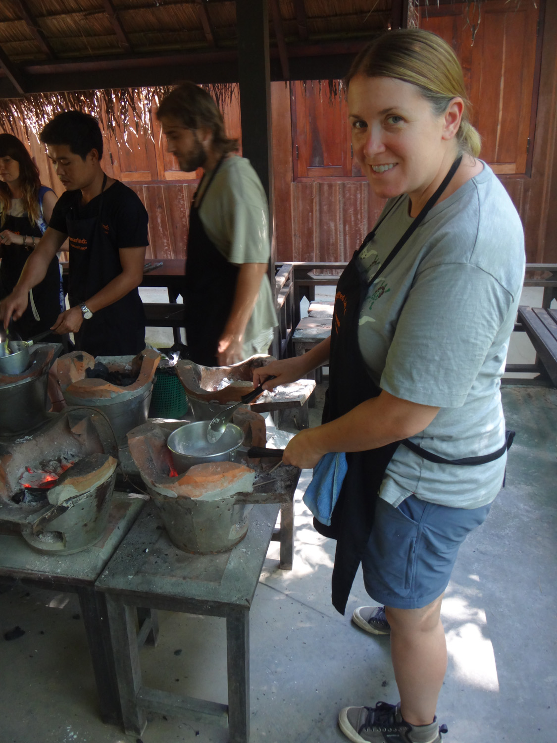 Cookin with a charcoal stove, the Laos way.