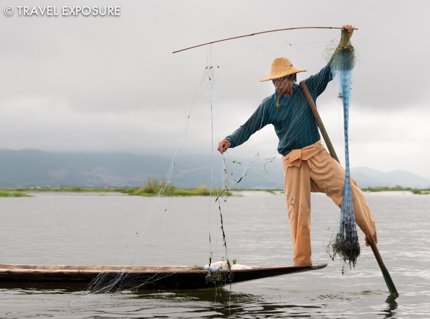 WEEK OF OCTOBER 13 A fisherman rows with his leg while pulling up a net on Inle Lake, Myanmar.