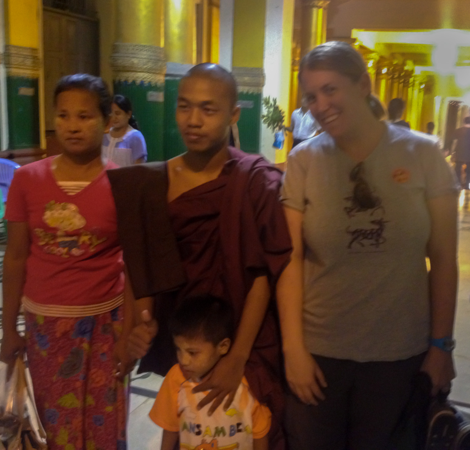 Posing for a photo with a monk in Myanmar.