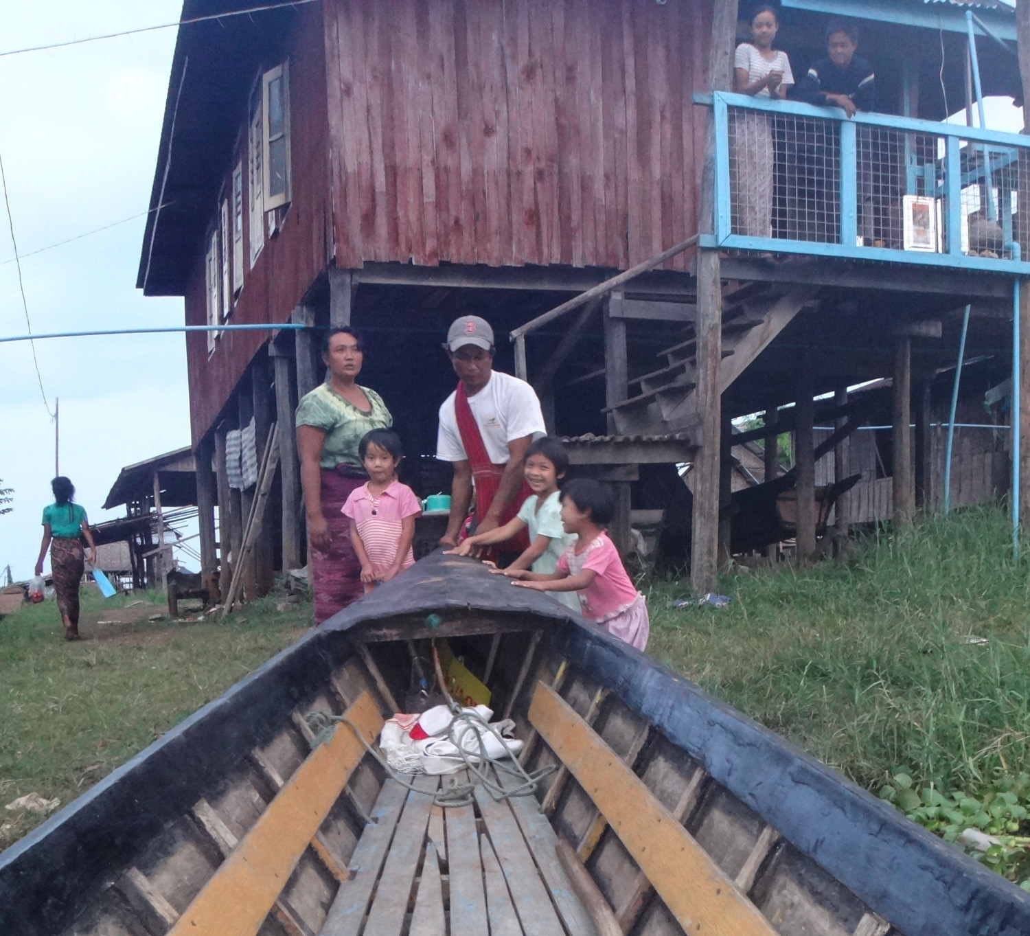Nmgsoe, our boatman, his wife, and some children from the village.