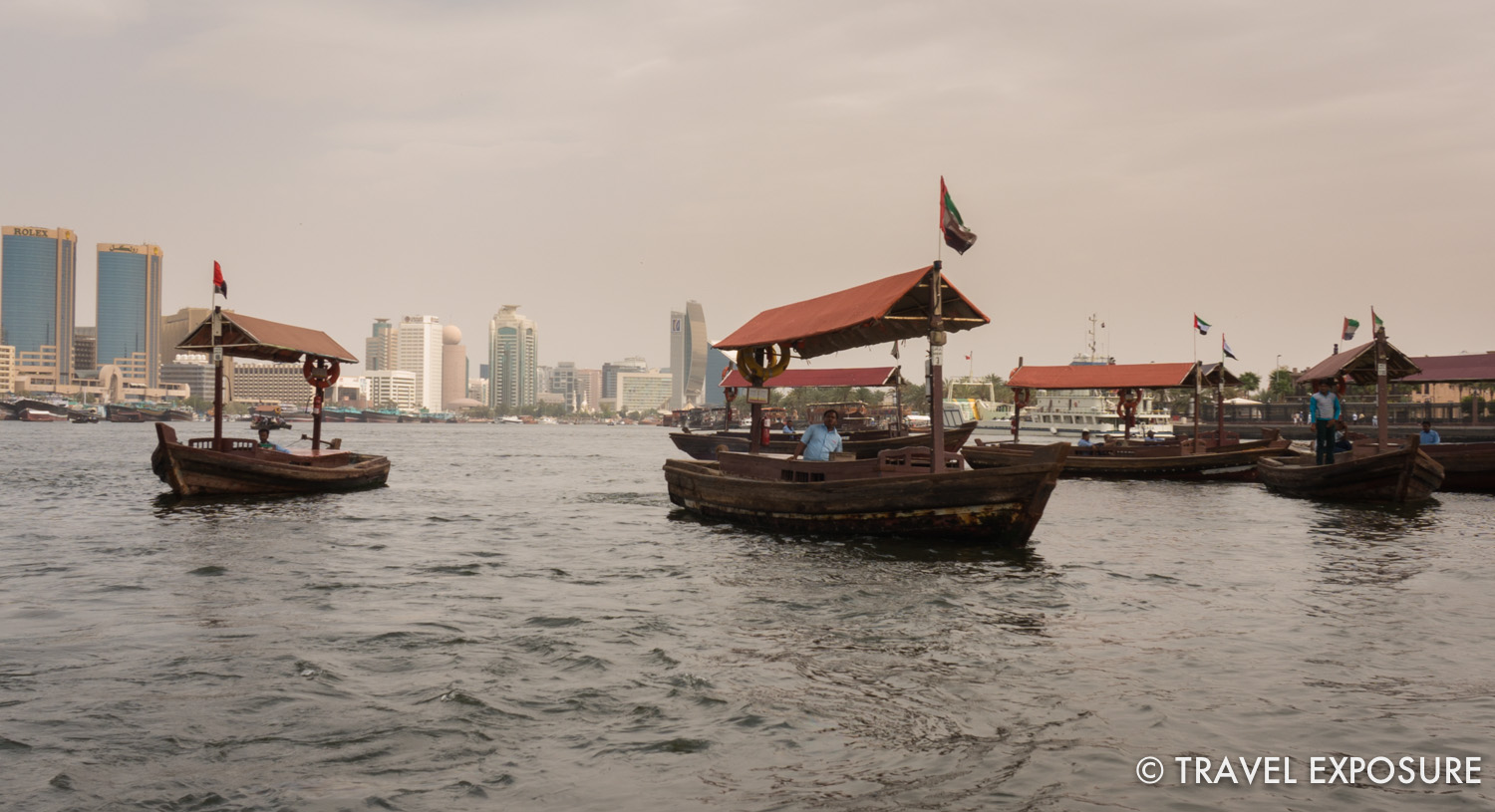 Crossing the Dubai Creek in an Abra, a traditional boat made of wood.