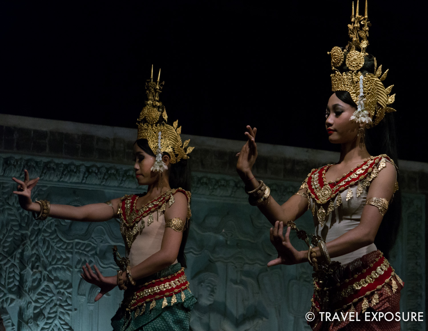 WEEK OF DECEMBER 1 Two women make delicate hand gestures during an Apsara dance in Siem Reap, Cambodia.