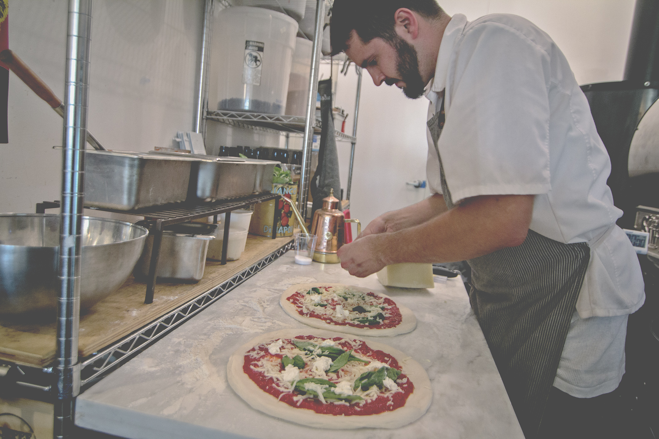 Hand tossed, hand crafted pizzas by Tribute Pizza. Photo by Jared Armijo-Wardle.