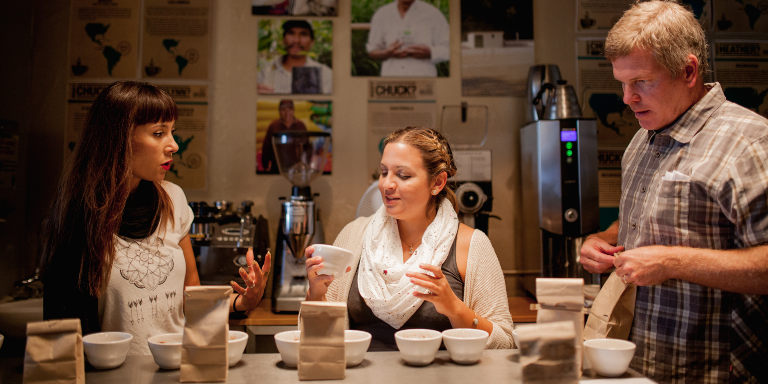Cupping at Bird Rock Coffee: (Left to right) Jocylynn Breeland, Anny Ruth and Chuck Patton. Photo by  Julie Rings .