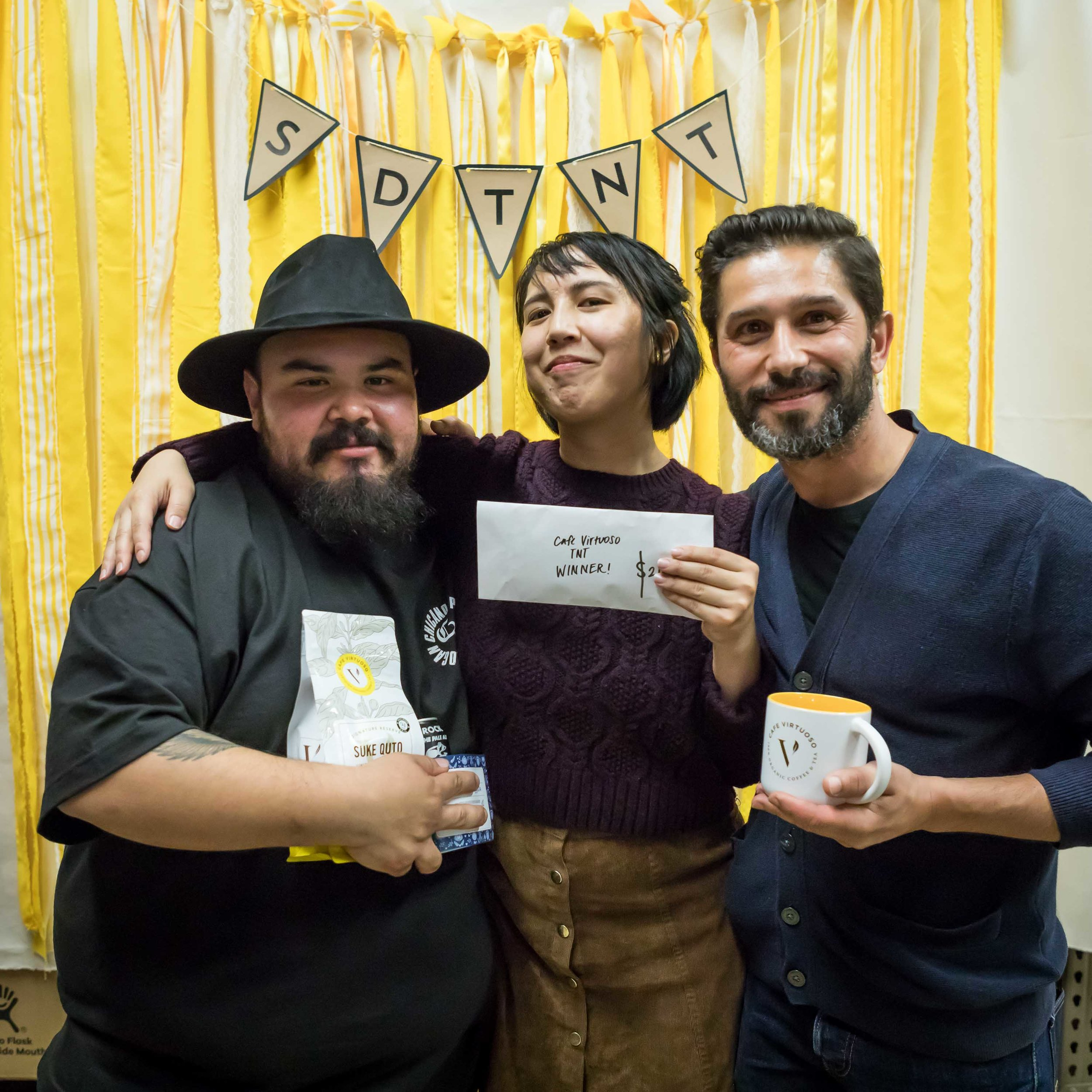 From left to right: Manny from Por Vida in 3rd place, Mary from Cafe Virtuoso in 1st place, Dimi from Parakeet in 2nd place
