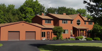 A spacious country estate with rolling lawns, pool, pond, and over 6500 top-of-the-line square feet of living space.
