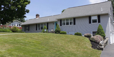 A spacious, sprawling home with a new kitchen, great decor, and a park-like lot.