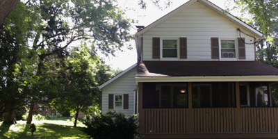 A fully renovated home on a large park-like yard with plenty of garage and storage space.