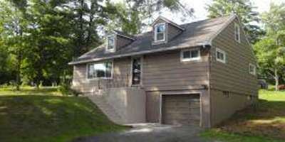 A spacious and updated home on over an acre just a couple minutes into the country.