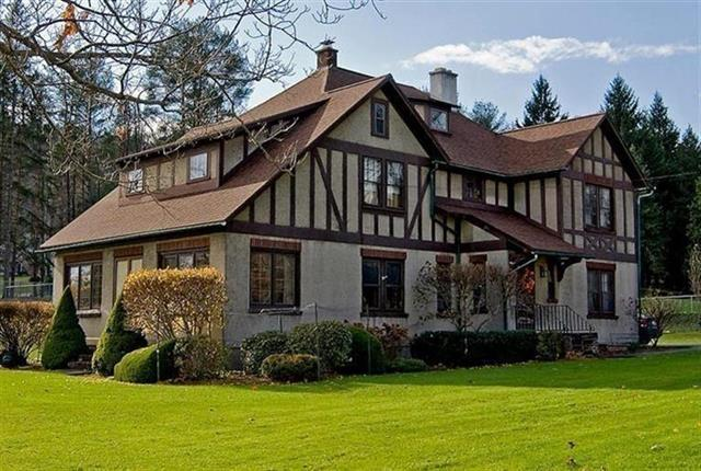 Beautiful Tudor Revival with lots of square footage on over an acre.
