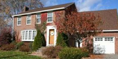 A stately brick 2-story with a gourmet kitchen in the heart of Chenango Bridge