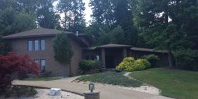 An expansive and luxurious brick contemporary home with low property taxes.